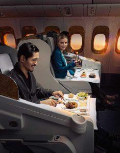 Passengers Enjoying Emirates Meals Onboard
