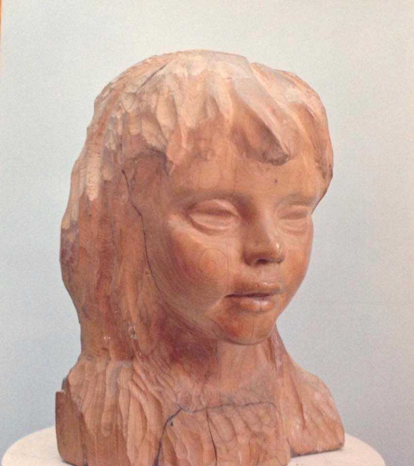 Bust of child, wood, 27 x 20 x 18 unsigned c. 1970.